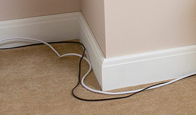 Skirting board cable tidy